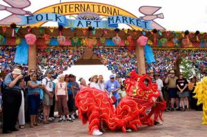 This undated image, provided by the International Folk Art Market, shows Vanh Hanh Vietnamese Lion Dancers entertaining the crowd at the International Folk Art Market in Santa Fe, N.M. This year's annual market begins July 10, 2015, and is expected to draw about 20,000 people and more than 150 artisans from around the world. (Bob Smith/ International Folk Art Market via AP)